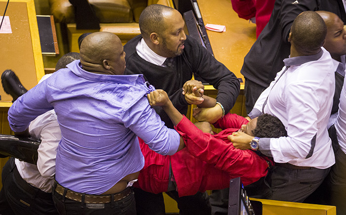 FILE: EFF MP Mbuyiseni Ndlozi is forcefully removed from the National Assembly along with other party members on 17 May 2016. Picture: Aletta Harrison/EWN