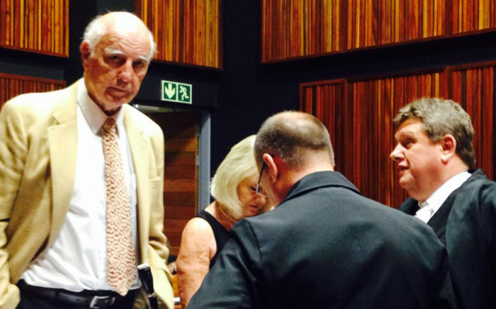 Bob Hewitt with his legal team preparing ahead of his trial at the Palm Ridge Magistrate Court on 10 February 2015. Picture: Masego Rahlaga/EWN.