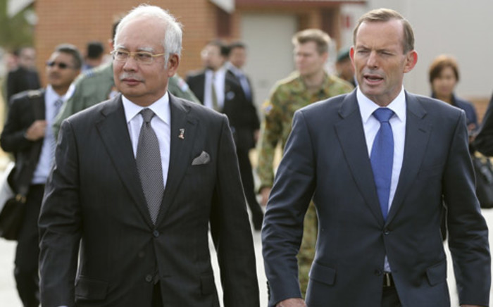 Malaysia Prime Minister Najib Razak walks with Australia's Prime Minister Tony Abbott on their way to meet crew members involved in the search of missing Malaysia Airlines flight MH370 at Pearce Airbase in Bullsbrook on 3 April, 2014. Picture: AFP.