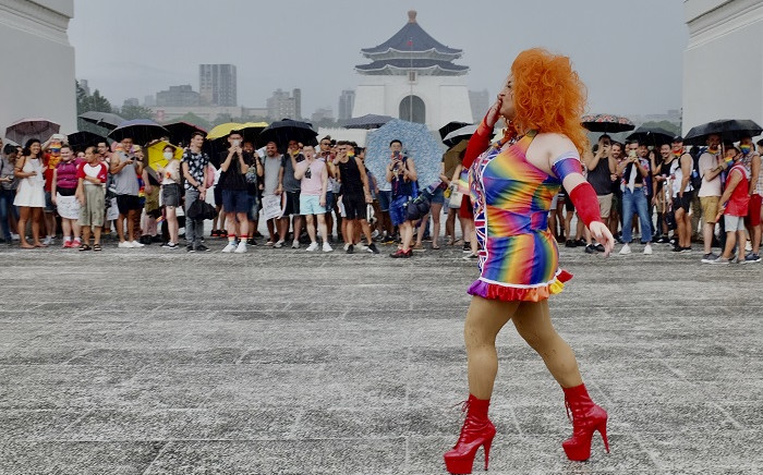 An LGBT rights activist poses for photos during a gay pride parade outside the Chiang Kai-shek Memorial Hall in Taipei on 28 June 2020. Picture: AFP