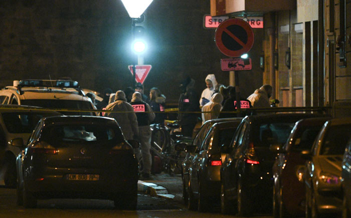 FILE: French police officers and forensics search for evidences at the site where Cherif Chekatt, the alleged gunman who had been on the run since allegedly killing three people at Strasbourg's popular Christmas market, has been shot dead by police on December 13, 2018 in the Neudorf neighbourhood of Strasbourg. Picture: AFP