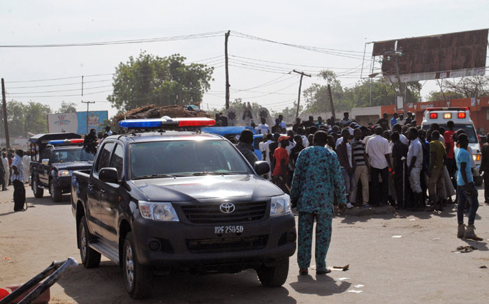 FILE: Emergency services, police and residents gather at the scene of a suicide bomb attack in Maiduguri. Picture: AFP.