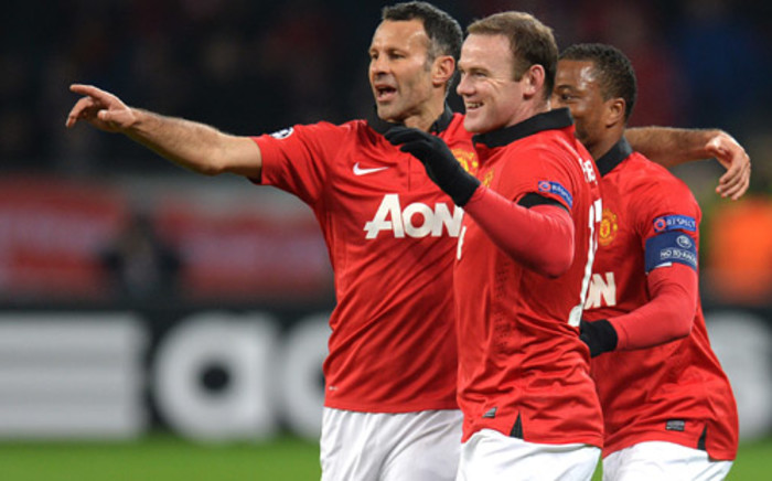 Manchester United's Ryan Giggs, Wayne Rooney and Patrice Evra celebrate after scoring during the UEFA Champions League Group A football match against Bayern Leverkusen. Picture: AFP.
