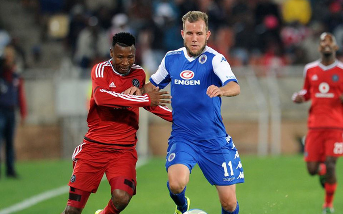 Orlando Pirates defender Siyabonga Sangweni and Supersport United striker Jeremy Brockie fight for the ball during the PSL match on 11 August 2015. Picture: PSL.