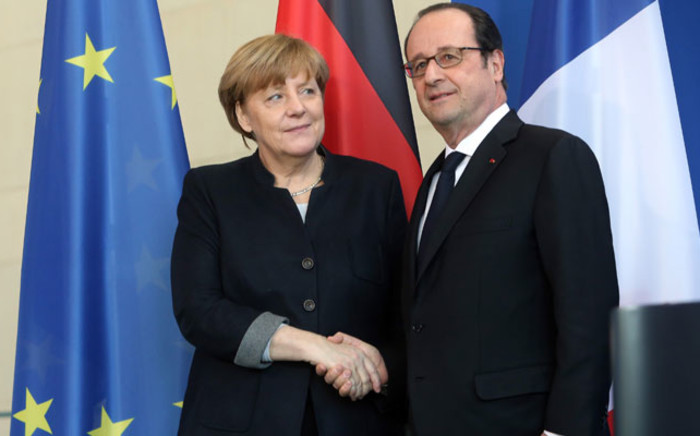 German Chancellor Angela Merkel (L) shakes hands with French President Francois Hollande prior to talks in the chancellery in Berlin on January 27, 2017. Picture: AFP.