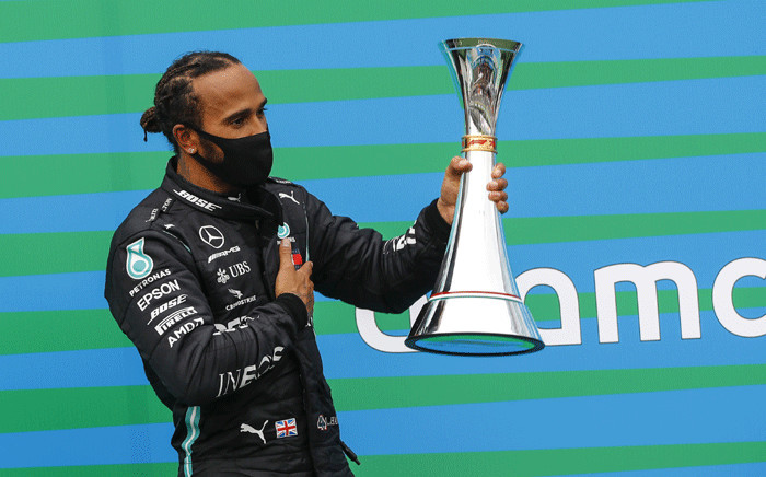 Mercedes' British driver Lewis Hamilton celebrates with the trophy on the podium of the Formula One Hungarian Grand Prix race at the Hungaroring circuit in Mogyorod near Budapest, Hungary, on 19 July 2020. Picture: AFP