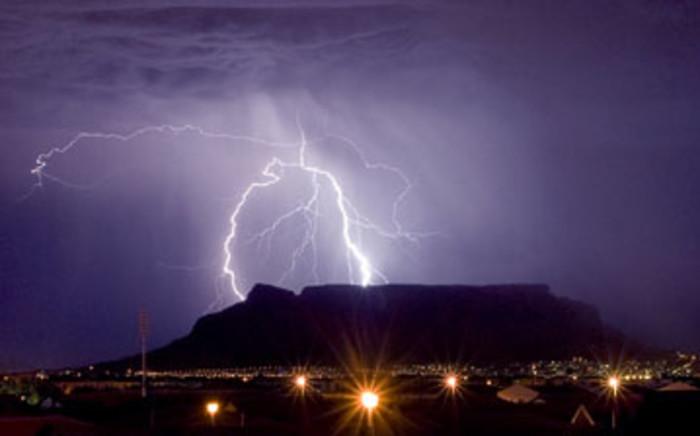 Lightining strikes behind Table Mountain.