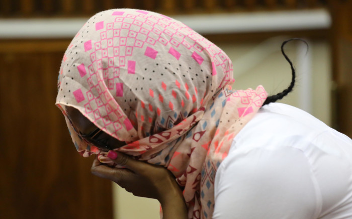 Convicted killer Sindisiwe Manqele sits in the dock during her sentencing at the High Court in Palm Ridge. Picture: Vumani Mkhize/EWN.