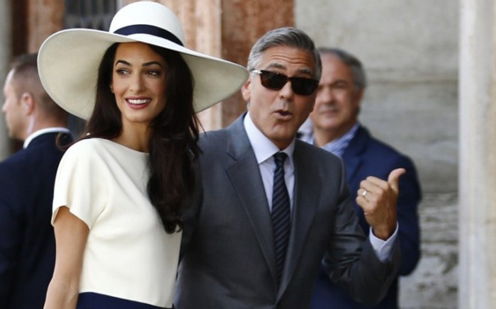FILE: US actor George Clooney and British lawyer Amal Alamuddin arrive on 29 September 2014 at the palazzo Ca Farsetti in Venice, for a civil ceremony. Picture: AFP.