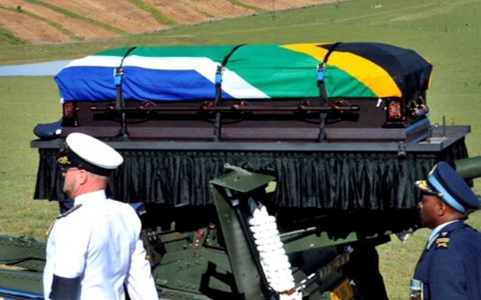 Nelson Mandela's casket is carried by military and police members on a gun carriage during his funeral service in Qunu, Eastern Cape, on 15 December 2013. Picture: GCIS