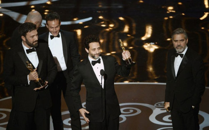 """Producer Grant Heslov accepts the Best Picture award for """"Argo"""" onstage during the Oscars held at the Dolby Theatre on February 24, 2013 in Hollywood, California. Picture: AFP/Kevin Winter"""