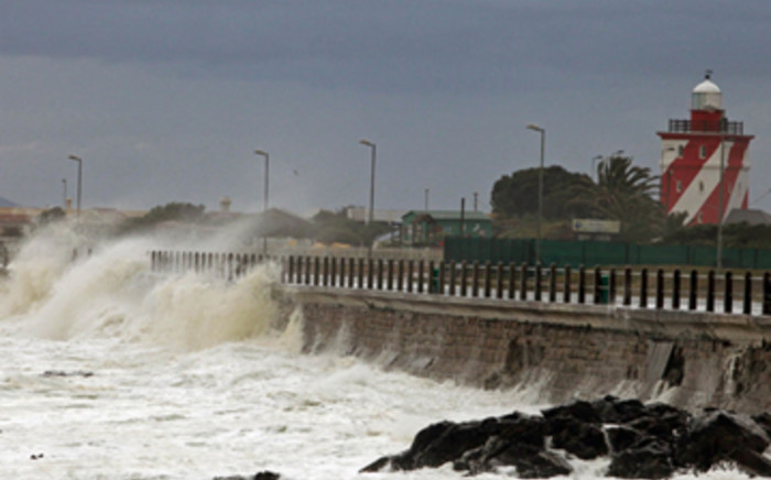 Huge waves hit the promenade wall at Three Anchor Bay on Thursday, 23 June 2011. Picture: Nardus Engelbrecht/SAPA