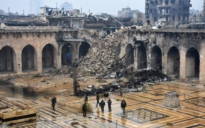 FILE: A general view shows Syrian pro-government forces walking in the ancient Umayyad mosque in the old city of Aleppo on 13 December 2016, after they captured the area. Picture: AFP.