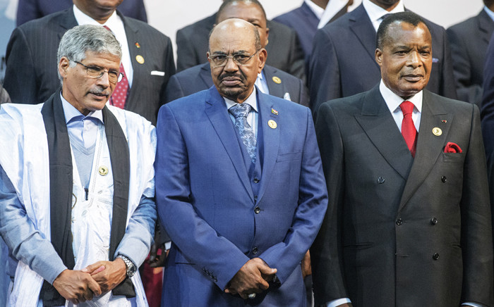 Sudanese President Omar al-Bashir (C), Congos president Denis Sasso-Nguesso (R) and Prime Minister of the Sahrawi Arab Democratic Republic Abdelkader Taleb Oumar (L) pose during a photo call at the 25th African Union Summit in Sandton South Africa on 14 June, 2015. Picture: AFP.