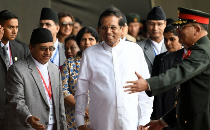 Sri Lankan President Maithripala Sirisena looks on as he arrives at Tribhuvan International Airport to attend the 4th Summit of the Bay of Bengal Initiative for Multi-Sectoral Technical and Economic Cooperation (BIMSTEC) in Kathmandu on 29 August 2018. Picture: AFP