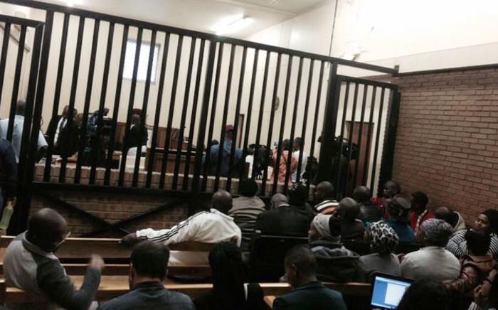 Families and friends of Zanokuhle Mbatha wait for court proceedings to start on 11 November 2014. Picture: Thando Kubheka/EWN.