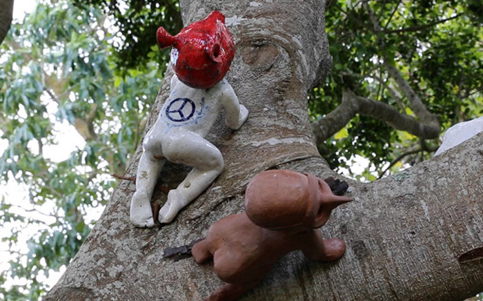 The artist displays her porcelain sculptures of babies with missing limbs in an oak tree. Picture: Renee de Villiers/EWN.
