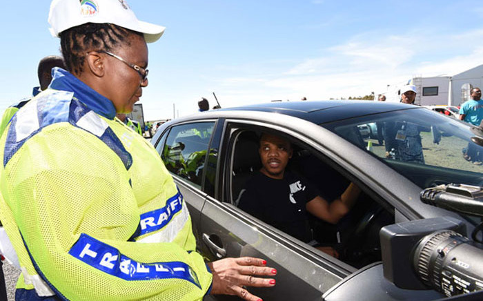 FILE: Transport Minister Dipuo Peters chats to a motorist. Picture: GCIS