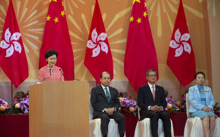 Hong Kong Chief Executive Carrie Lam (L) speaks during a ceremony to mark China's National Day in Hong Kong on 1 October 2020, which commemorates the 71st anniversary of the establishment of the People's Republic of China. Picture: AFP
