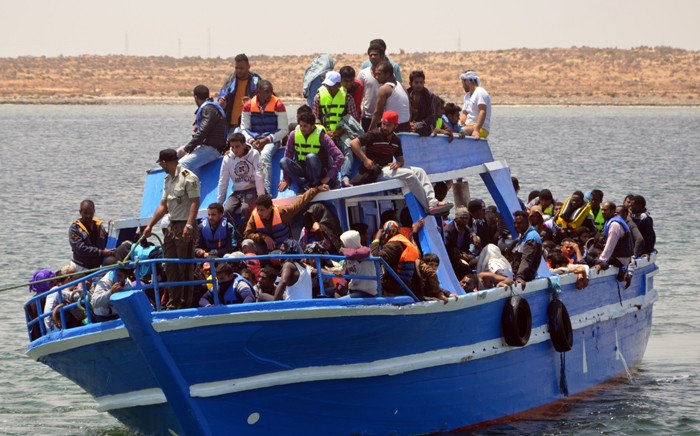 Migrants arrive at the port in the Tunisian town of Ben Guerdane, some 40 km west of the Libyan border, following their rescue by Tunisia's coastguard and navy after their vessel overturned off Libya, on 10 June, 2015. Picture: AFP.