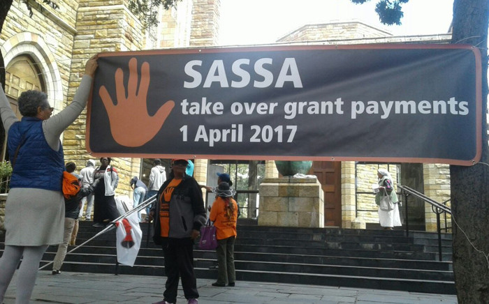"Social grant beneficiaries and civil society partners making their way into St George's Cathedral for the ""Hands Off our Grants"" Service. Picture: Twitter/@black_sash"