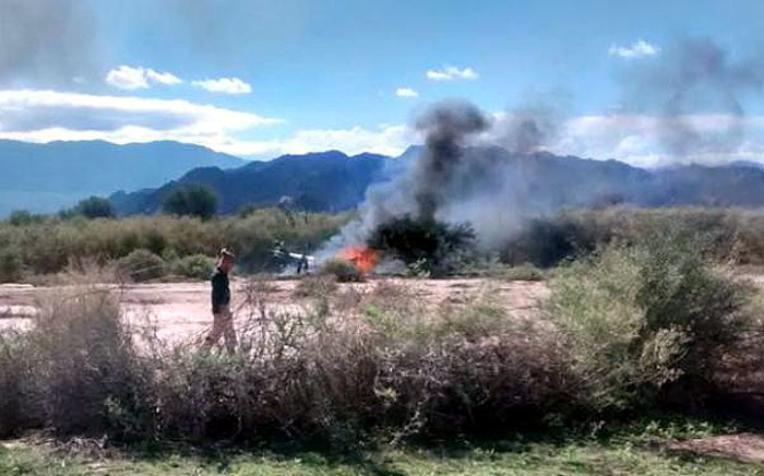 A helicopter in flames after crashing into another in Argentina. French sports stars were among those killed during the filming of a French reality TV series on 9 March 2015. Picture: AFP