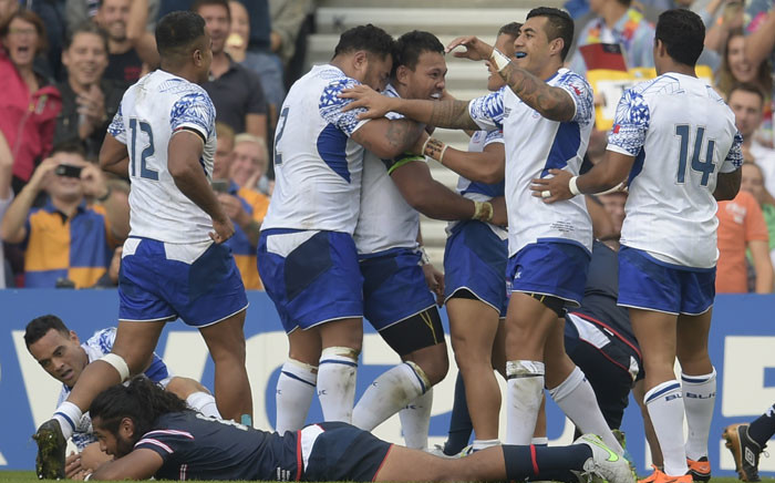 FILE: Samoan players celebrate after scoring a try during a Pool B match of the 2015 Rugby World Cup against the US on 20 September 2015. Picture: AFP.