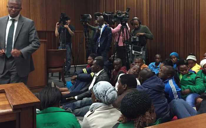"""More people enter the North Gauteng High Court saying the """"Judge must see how serious this is"""", during the urgent application into the release of the Marikana report on 08 June 2015. Picture: Gia Nicolaides/EWN."""