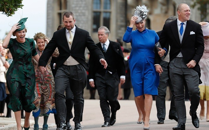 FILE Peter Phillips (2L), Autumn Phillips (L), Zara Tindall (2R) and Mike Tindall (R) arrive to attend the wedding of Britain's Princess Eugenie of York to Jack Brooksbank at St George's Chapel, Windsor Castle, in Windsor, on 12 October 2018. Picture: AFP