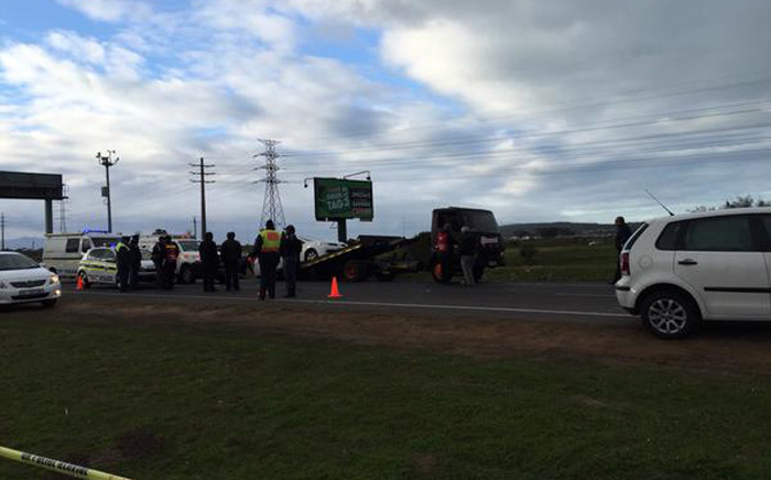 FILE: Police and forensic experts at the scene where a police officer was stabbed to death in an attack on the N2 highway. Picture: Natalie Malgas/EWN.