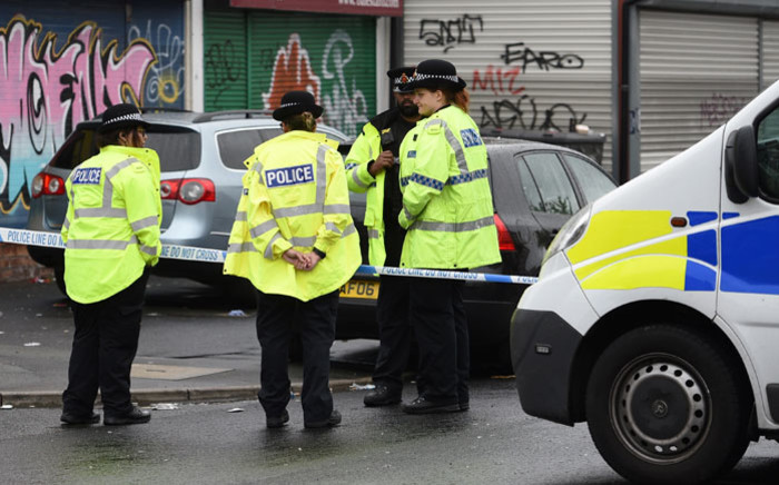 FILE: Manchester police at a crime scene. Picture: AFP