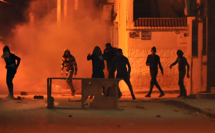 Tunisian protesters throw stones towards security forces in Tunis' Djebel Lahmer district early on 10 January, 2018 after price hikes ignited protests in the North African country. Picture: AFP