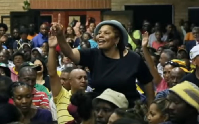 A screengrab of a community member objecting to ANC member Danny Jordaan's running of a meeting during President Cyril Ramaphosa's election campaign visit to Riverlea on 14 March 2019.