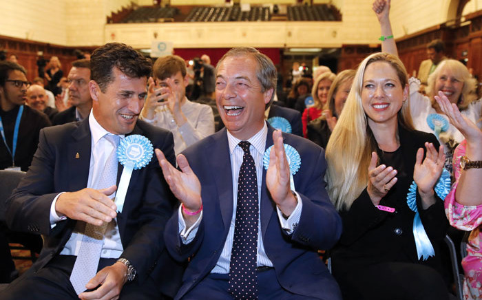Brexit Party leader Nigel Farage (centre) reacts after the European Parliament election results for the UK South East Region are announced at the Civic Centre Southampton, Southern England, on early 27 May 2019. Picture: AFP