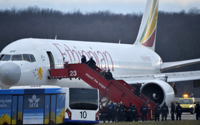 Police evacuate passengers on 17 February, 2014 from the Ethiopian Airlines flight en route to Rome, which was on hijacked and forced to land in Geneva, where the hijacker has been arrested, police said. Picture: AFP.