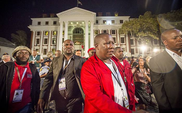 Julius Malema leaves parliament after making a statement to press in response to how the EFF were thrown out of the State of the Nation Address 2015. Picture: Thomas Holder/EWN