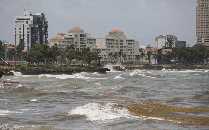 Strong waves and sargassum brought by the tide are seen at the Malecon after the passage of storm Elsa in Santo Domingo, on July 4, 2021. Picture: Erika Santelices / AFP