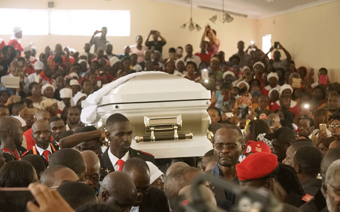 FILE: The casket of late opposition leader Morgan Tsvangirai is carried into Mabelreign Methodist Church in Harare for a memorial service on 18 February 2018. Picture: AFP.