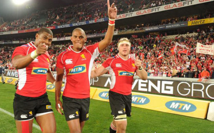 FILE: Golden Lions players celebrate with fans after their thundering win against Southern Kings at Ellis Park, which secured them a spot into Super Rugby. Picture: Lions official facebook page.