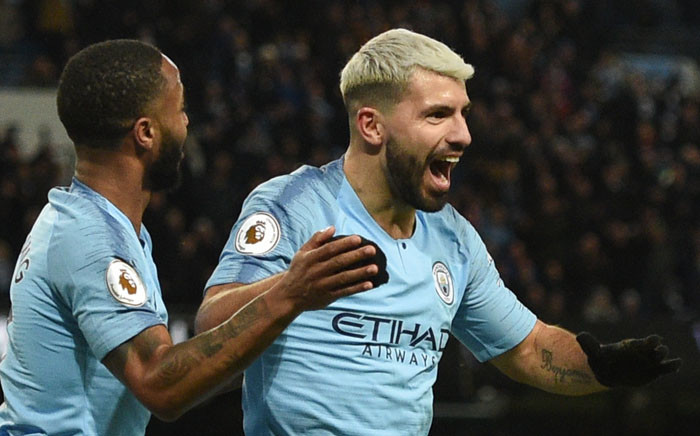 Manchester City's Argentinian striker Sergio Aguero (R) celebrates scoring their third goal to complete his hattrick during the English Premier League football match between Manchester City and Arsenal at the Etihad Stadium in Manchester, north west England, on 3 February 2019. Picture: AFP