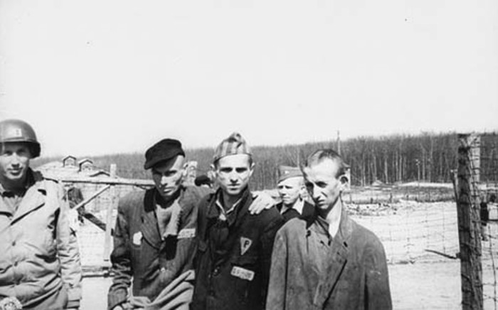 An American captain with survivors in the Buchenwald concentration camp. Picture: Wikimedia Commons.