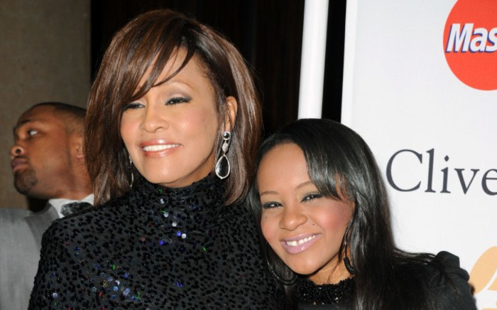 FILE: The late Whitney Houston (L) and her daughter Bobbi Kristina Brown (R) in Beverly Hills in 2011. Picture: Getty Images/AFP.