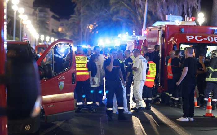 FILE: Police officers, firefighters and rescue workers are seen at the site of an attack on the Promenade des Anglais on July 15, 2016, after a truck drove into a crowd watching a fireworks display in the French Riviera town of Nice. Picture: AFP