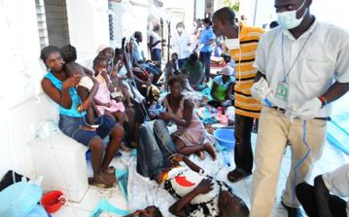 Victims wait at a medical facility on 22 October 2010 in St. Marc, northern Haiti, amid a cholera epidemic. Picture: Thony Belizaire/AFP.