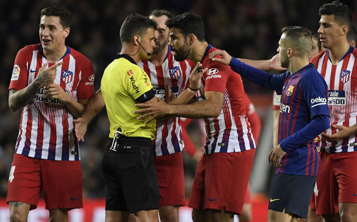 In this file photo taken on 6 April 2019 Atletico Madrid's Spanish forward Diego Costa (C-R) argues with Spanish referee Gil Manzano before receiving a red card during the Spanish league football match between FC Barcelona and Club Atletico de Madrid at the Camp Nou stadium. Picture: AFP