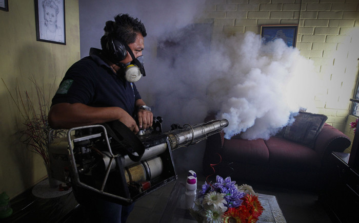 A worker of the Salvadorean Ministry of Health fumigates a house in Soyapango as part of a campaign of fumigation to reduce the presence of the mosquito that transmits the Zika virus. Picture: EPA/Oscar Rivera.