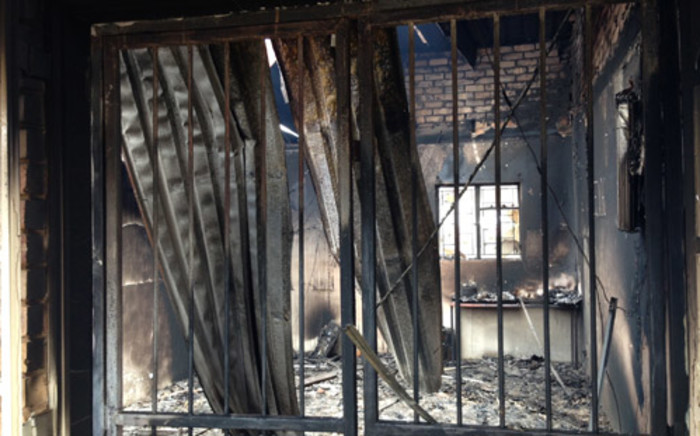 The Rethabiseng Clinic which was set on fire by angry residents, 5 February 2014. Picture: Sebabatso Mosamo/EWN.