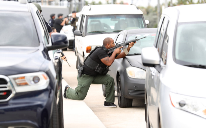 First responders secure the area outside the Fort Lauderdale-Hollywood International airport after a shooting took place near the baggage claim on 6 January, 2017 in Fort Lauderdale, Florida. Picture: AFP.