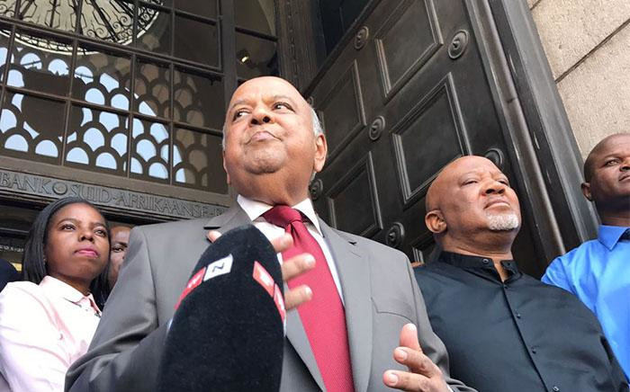 Outgoing Finance Minister Pravin Gordhan and Deputy Finance Minister Mcebisi Jonas speak outside Treasury after being axed in a Cabinet reshuffle. Picture: Barry Bateman/EWN