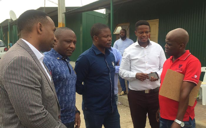 Self-proclaimed prophet Shepherd Bushiri speaks to authorities during a visit at the Stjwetla informal settlement following a fire that burnt over 100 shacks in the area. Picture: Ahmed Kajee/EWN